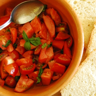 Let the ingredients sit for a minute or two for that tasty tomato/olive oil mixture to develop and thats it...