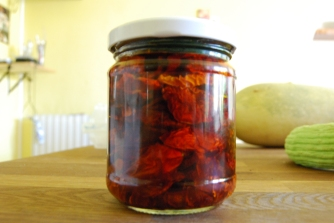 Clean and sterilise your chosen jar and lid. When your tomatoes are dry, put them in the jar gently layering them on top of each other.