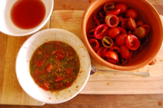 Dig out the insides of your tomato halves with a teaspoon making sure you've removed all the seeds. Put your vinegar in a bowl and dip each empty tomato half into it - making sure the scooped out part is covered in a little vinegar.